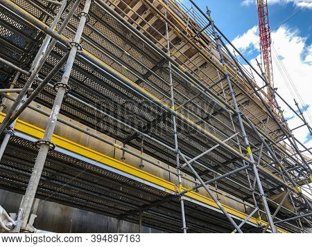Scaffoldings At Construction Site. Auxillary Construction Equipment