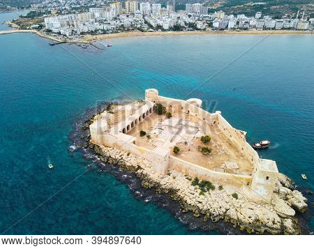 Ancient Fortress Kizkalesi Or Maiden Castle. Aerial View Of Fortress And Town