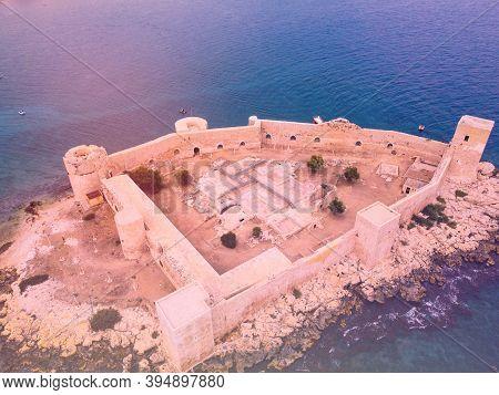 Ancient Fortress Named Kizkalesi Or Maiden Castle At Mediterranean Island Aerial