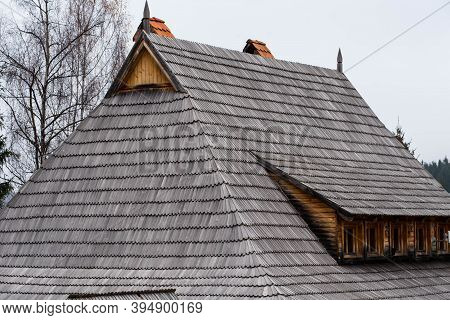 Traditional Pine Wood Shingle Roofing  On A Log House, The Shingles Are Hand Made.