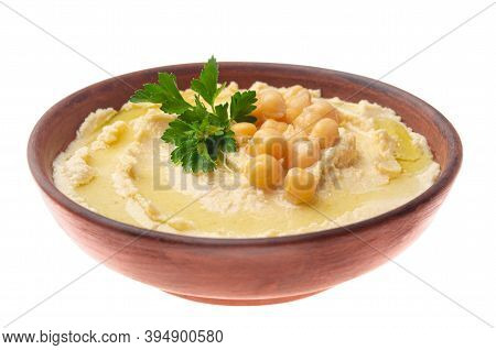 Hummus Made Of Cooked, Mashed Chickpeas Topped With Beans And Green Coriander Leaves Isolated On Whi