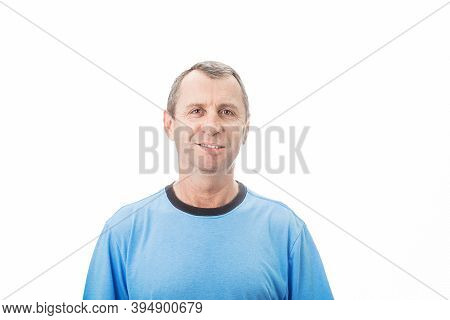 Confident Middle Age Man Smiling Wearing Casual T-shirt  Isolated Over White Background .   Portrait