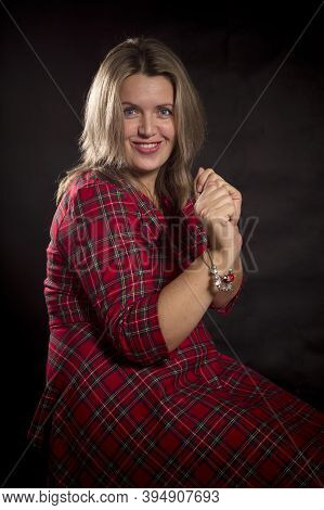 Cheerful 40 Years Old Woman In Red And Black Dress Studio Portrait