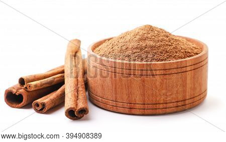 Cinnamon Sticks And Cinnamon Powder In A Plate On A White Background. Isolated