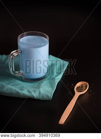 Moon Milk Is A Drink Made From Milk And Blue Water. Thai Flower Tea In A Glass Cup On A Black Backgr