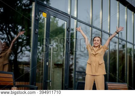 Business Success - Happy Young Business Woman Celebrating Work Career Achievements With Both Hands U