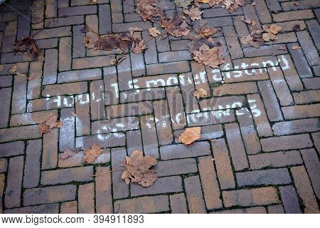 Worn And Weathered Drawing On Pavement In Dutch Letters Means, Keep 1.5 Meter Social Distancing, Als