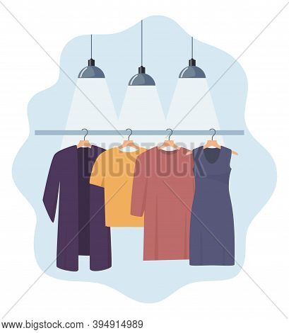 Clothes Hang On A Hanger, Illuminated By Lamps. Fashion Boutique, Assortment Showroom. Women's Perso