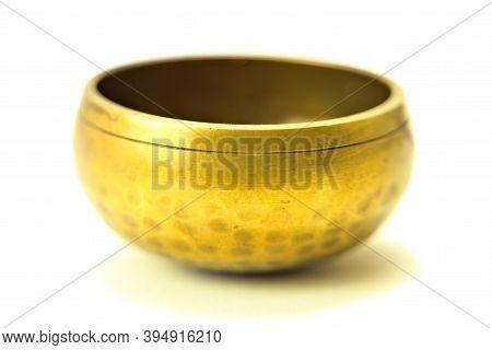 Bronze Meditation Singing Bowl Isolated On White.