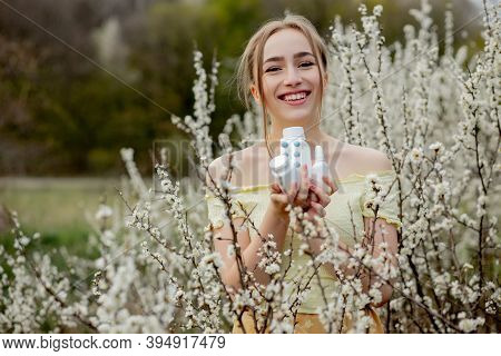 Woman With Medicine In The Hands Fighting Spring Allergies Outdoor - Portrait Of An Allergic Woman S