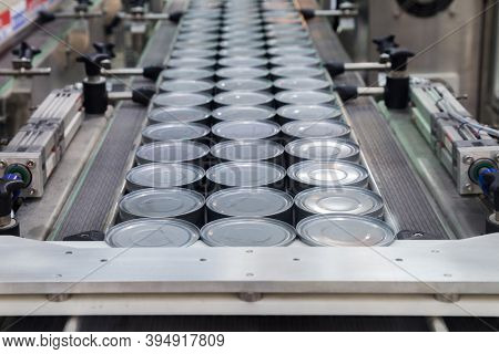 Aluminum Cans For Food Processed In Factory Line Conveyor Machine At Canned Food Manufacturing, Sele