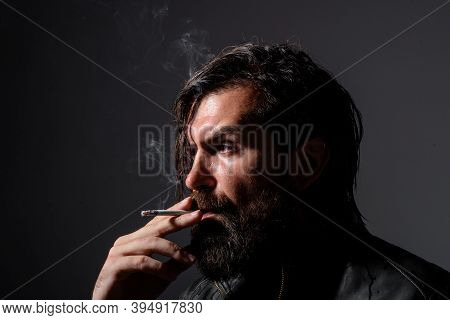 Handsome Man Smoke The Cigarette. Hipster With Cigarette. Cigarette Smoke. Sensual Man Smoking Outsi