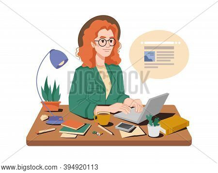 Journalist At Her Workplace Writes Article Or Post On Laptop, Cup Of Tea Or Coffee, Books And Pens,