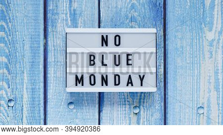 Blue Monday Day Banner Concept. White Board With Text No Blue Monday On Blue Wooden Background, Top