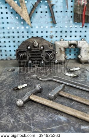 Motorists Workplace. Old Tools Set On Metallic Table With Tools And Motorparts