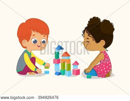 Preschool Red Hair Boy And African American Girl Kids Playing With Wooden Bricks And Blocks Together