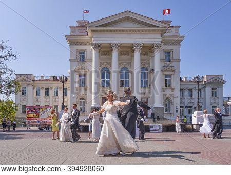 Sevastopol, Russia - September 29, 2020: Elderly Couples Dance A Waltz Over Background Of Building O
