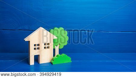 Wooden Houses And Trees. Affordable Comfortable Housing. Purchase Of Real Estate, Rent Or Sale. Eco