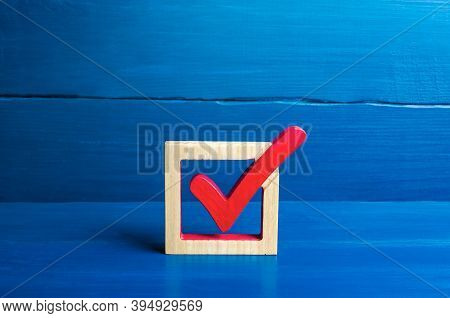 Red Voting Check Mark On A Blue Background. Voting Concept For Democratic Elections. Make The Best C