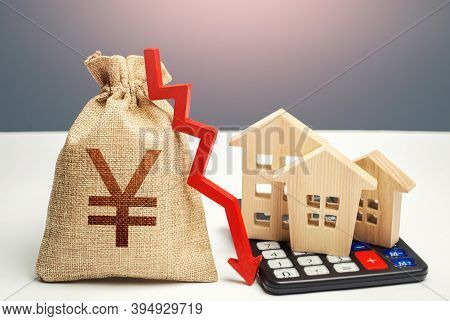 Yuan Yen Money Bag With Down Arrow And Houses On Calculator. Saving Resources And Reducing Maintaini