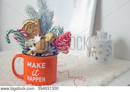 Christmas Composition With Homemade Sweet Gifts. Large Orange Mug With Homemade Cookies, Nuts, Sweet