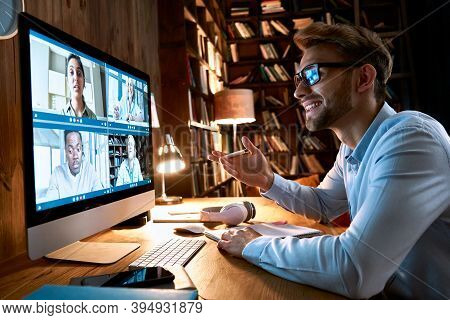 Business Man Having Virtual Team Meeting On Video Conference Call Using Computer. Social Distance Wo