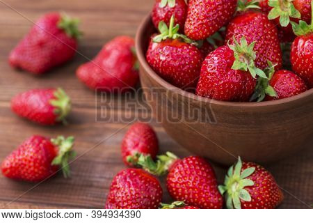 Fresh Strawberries In A Bowl On Wooden Table. Strawberry In A Bowl.