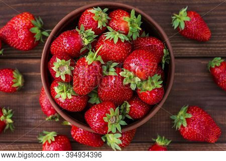 Fresh Strawberries In A Bowl On Wooden Table. Strawberry In A Bowl. Top View.