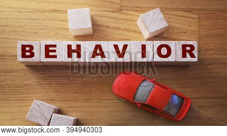 Behavior Word In Wooden Cube And Red Toy Car. Child Behavior Microagression Self Control Concept