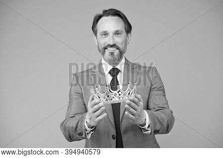 Crown For Man Who Deserves It. Happy Businessman Hold Crown Grey Background. Kings Crown. Royal Coro