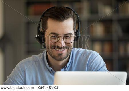 Man Wear Headset Use Laptop Talk To Friend By Videocall