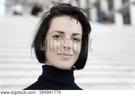 Girl Or Woman Smile With Natural Makeup Face And Brunette Hair On Stairs Outdoor. Beauty, Look, Visa