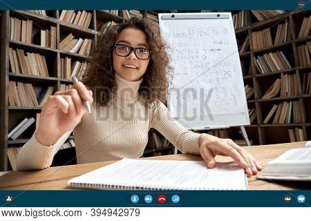 Female Young Hispanic Latin School Teacher, College Tutor Coach Talking To Web Camera Virtual Teachi