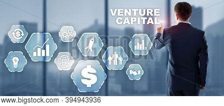 Businessman Select Venture Capital On Virtual Screen.