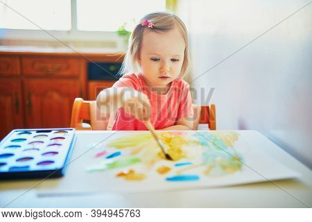 Adorable Little Girl Drawing With Colorful Aquarelle Paints At Home, In Kindergarten Or Preschool. C