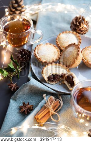 Mince Pies On A Plate Served With Black Tea. A Mince Pie Is A Traditional Christmas Sweet Pie, Fille