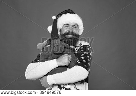 Hug Is Mood Enhancer. Happy Santa Embrace Reindeer Toy. Bearded Man In Cool Mood. Awesome Holiday Mo