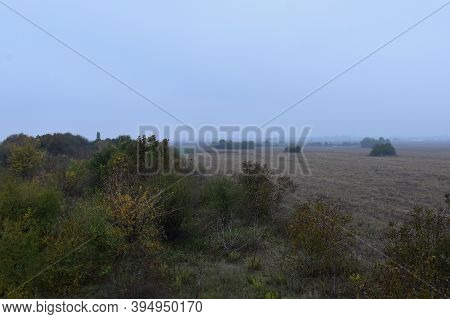 Autumn Landscape With A Haze In The Air