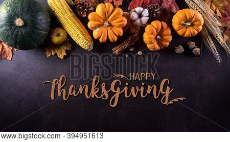 Thanksgiving Background Decoration From Dry Leaves And Pumpkin On  Dark Stone Background. Flat Lay,