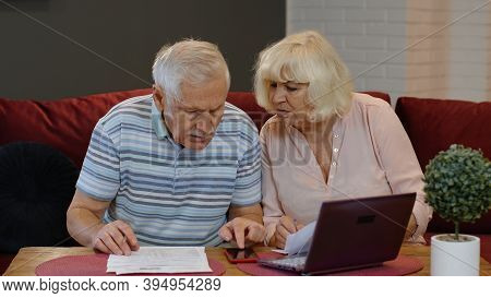 Worried Senior Retired Couple Checking Calculating Bills Bank Loan Payment Doing Paperwork Discuss U