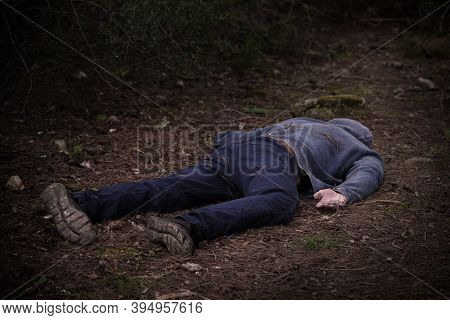 A Caucasian Mans Dead Body Was Found In The Park. Murder In The Woods. Murdered Citizen. Crime Scene