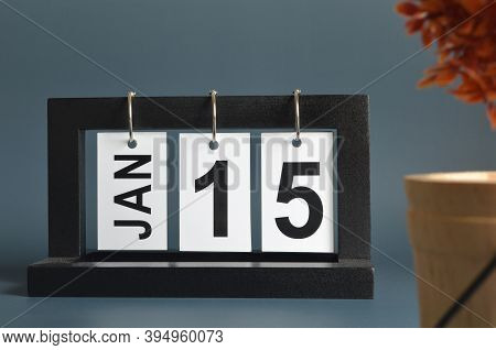January 15, Date Design With A Black Wooden Calendar For A Business, Date Plans To Remind.