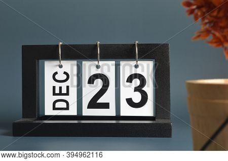 December 23, Date Design With A Black Wooden Calendar For A Business, Date Plans To Remind.