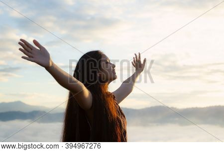 Freedom Of Woman Concept: Happy Girl On Mountain Sunrise