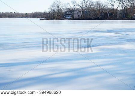 Landscape Of Frozen Lake In Residential Area