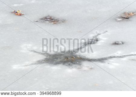 Texture Of The Frozen Lake Surface As Background