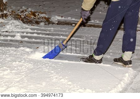 The Guy Removes Snow In The Yard. A Man Shovels Snow In The Yard In The Early Morning. Snowy Winter