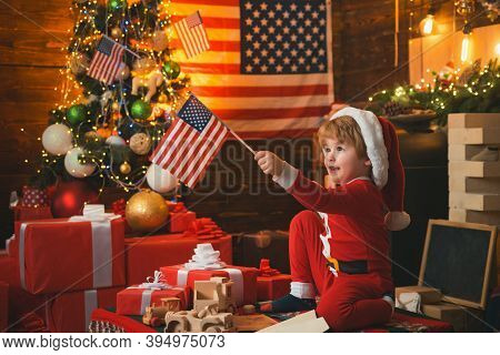 Happy Christmas Kid With Usa Flags. Merry Christmas In America. Christmas With American Flag Backgro