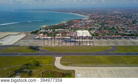 Commercial Aircraft Taxi On The Runway At Denpasar Airport In Bali, Indonesia. Drone View Of A Big J