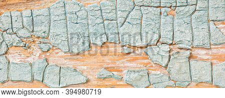 Texture Of Thick Cracked Layer Of Light Blue Paint On Old Wood.